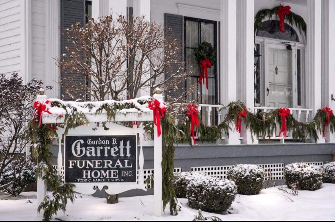 Image of Gordon B. Garrett Funeral Home exterior at Christmas