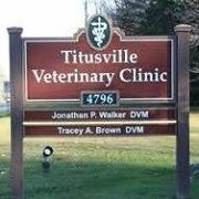 Image of Brown and white lettered Titusville Veterinary Clinic Sign in Titusville, Pennsylvania